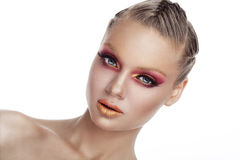 Woman with red and gold art stage make up on white background. In studio photo. Beauty and fashion. Art stage conceptul make up stock images