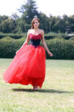 Woman in a red gothic dress Royalty Free Stock Photos