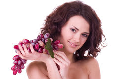 Woman with red grape Stock Image