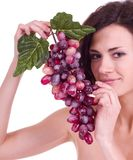Woman with red grape Royalty Free Stock Images
