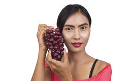 Woman with red grapes Royalty Free Stock Images