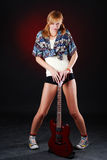 Woman with red guitar Stock Images