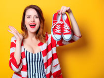 Woman with red gumshoes Royalty Free Stock Photography