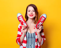 Woman with red gumshoes Stock Image