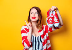 Woman with red gumshoes Royalty Free Stock Photos
