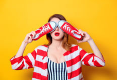 Woman with red gumshoes Royalty Free Stock Images