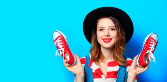 Woman with red gumshoes Stock Images