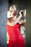 Woman in red with gun Stock Photos