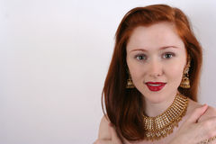 Woman with red hair. A beautiful caucasian white adult young woman head portrait with long straight red hair and friendly smiling expression in her attractive Stock Images