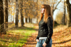 Woman with red hair in autumn park Royalty Free Stock Photography