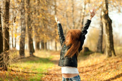 Woman with red hair in autumn park Royalty Free Stock Photos