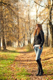 Woman with red hair in autumn park Stock Image