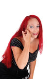 Woman with red hair bending down. Stock Photo