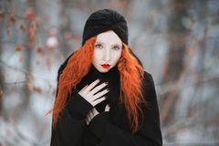 Beautiful attractive girl with red hair Stock Photo