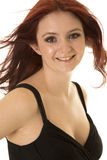 Woman red hair blow black dress smile. A woman with a smile on her face with her hair being blown Stock Photos