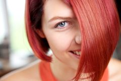 Woman with red hair and blue eyes smiling Royalty Free Stock Photography