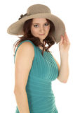 Woman red hair green dress hat touch Royalty Free Stock Photography
