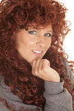 Woman red hair hand under chin Royalty Free Stock Photography