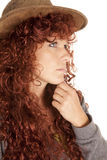 Woman red hair hat close hand chin Royalty Free Stock Photos