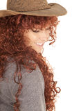 Woman red hair hat smile look down Royalty Free Stock Photos