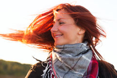 Woman with red hair have fun on the cost in sunlight Stock Photo
