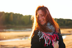 Woman with red hair have fun on the cost in sunlight Royalty Free Stock Photography