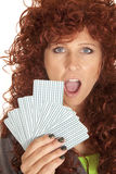 Woman red hair look over fan of cards shock Stock Images
