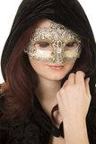 Woman red hair mask cloak look down Stock Photography