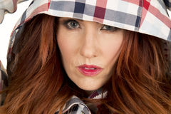 Woman with red hair in plaid hood close serious look Royalty Free Stock Photography