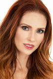Woman with red hair portrait small smile Royalty Free Stock Image