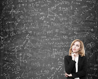 Woman with red hair solving a difficult problem Royalty Free Stock Photography