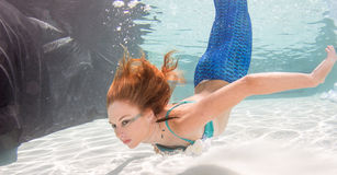 Woman with red hair in a swimming pool. Stock Images