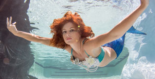 Woman with red hair in a swimming pool. Royalty Free Stock Photo