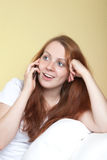 Woman with red hair talking on the phone Royalty Free Stock Photography