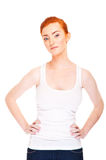 Woman with red hair in tank top over white background Royalty Free Stock Photos
