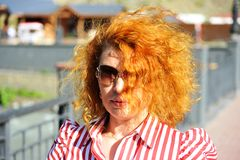 Woman with red hair wearing sunglasses Royalty Free Stock Photo