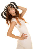 Woman with red hair in white dress and hat lean back Stock Images