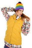 Woman with red hair in yellow vest and hat look down Royalty Free Stock Photo