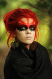 Woman with red hairs and black make-up mask Royalty Free Stock Photos