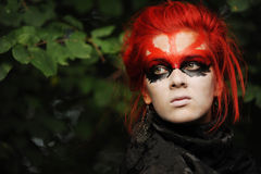 Woman with red hairs and black make-up mask Royalty Free Stock Images