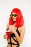 Woman with red hairs drink red cocktail. Stock Photos