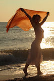 Woman with red handkerchief is on beach Stock Images