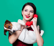 Woman with red handset and dog Royalty Free Stock Photos