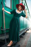 Woman in red hat against old railway wagon Stock Photography