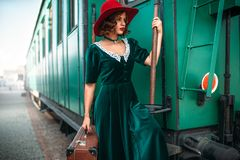 Woman in red hat against old railway wagon Royalty Free Stock Photography