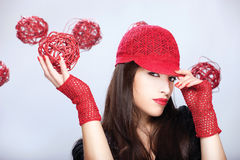 Woman with red hat holding red ball Royalty Free Stock Photography