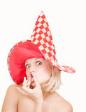 Woman in red hat making a funny face on white Stock Photography