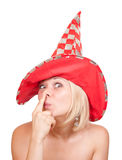 Woman in red hat making a funny face on white Royalty Free Stock Photos