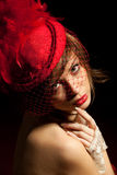 Woman in red hat with net veil stock photo