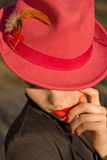Woman in red hat. Red lips and manicure. Royalty Free Stock Photography